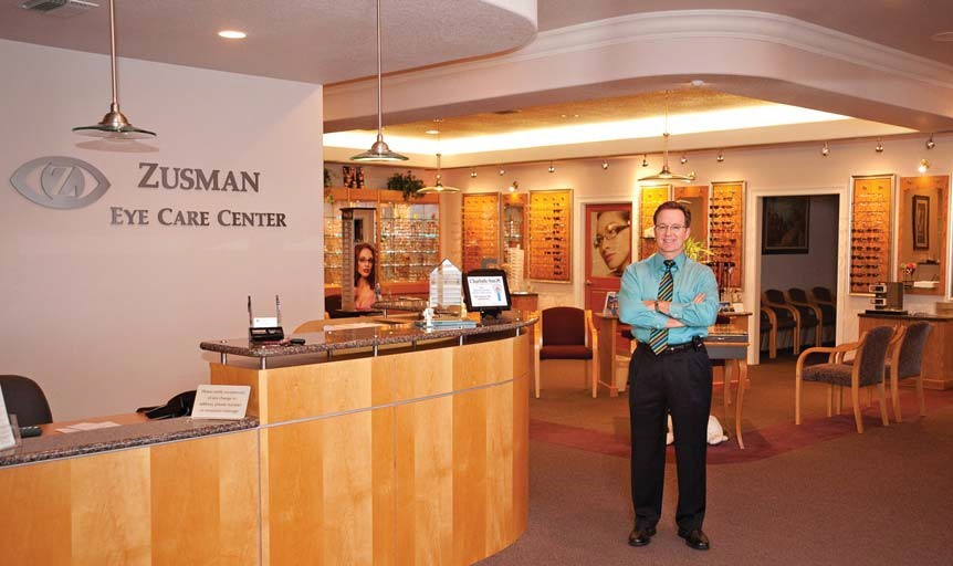 Dr. Neil Zusman stands near the front desk at Zusman Eye Care Center in Port Charlotte, Florida